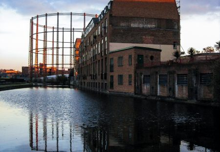 Gasometer reflected in a canal, Hackney, London.
